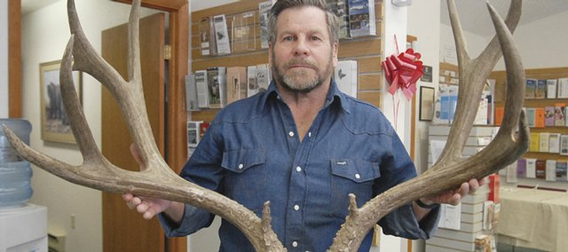 Craig resident Darwin Vesely displays the antlers from his prize mule deer. Vesely's kill measure's 203 inches. The Moffat County record is 197.