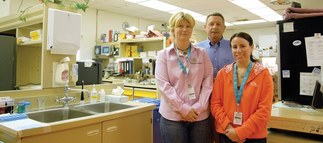 The Memorial Hospital employees, from left, Kristine Cooper, lab manager, Dr. Robert Collins and Marie Etzler, lab supervisor, stand in the current lab at the hospital, which will be switching June 24 to the Mayo Medical Laboratories for outside testing. The trio traveled in May to the world-renowned Mayo Clinic in Rochester, Minn., to see where they would be sending lab work in the future.