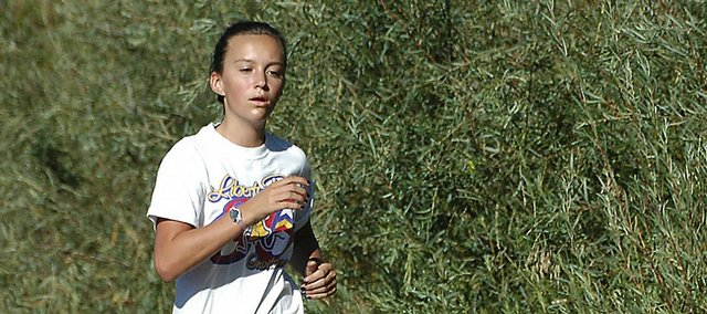 MCHS junior Nike Cleverly keeps pace Aug. 23 during the cross-country time trials.
