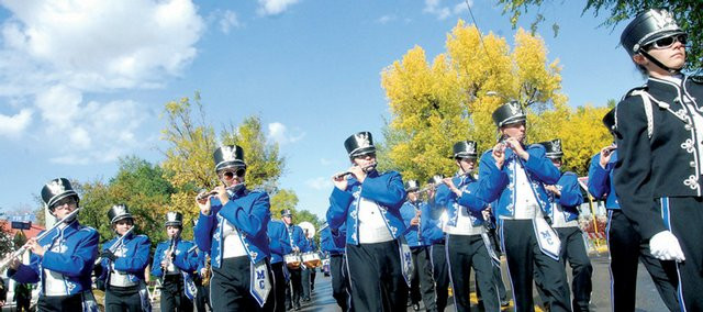 The Moffat County High School band makes its way down Yampa Avenue on Friday. 