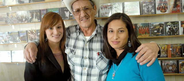 Eutiquio Pereyra, middle, owner of El Ranchero, poses for a photo with his nieces Jade Pereyra Payañ, left, 19, and Esmeralda Pereyra Payañ, 25, inside his store, which is located near a restaurant and goes by the same name. Jade and Esmeralda are in town, visiting their uncle from Chihuahua, Mexico. Pereyra said he's seen about 30 percent fewer customers during the past six months than he did last year.
