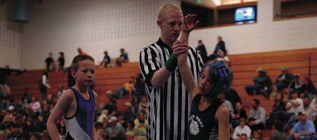 Bad Dog wrestler Ethan Powers, right, is declared a winner against Dusty Hattenburgh, of New Castle, on Saturday at Moffat County High School. Eight teams competed in the MCHS gymnasium for the Bad Dog's lone home tournament of the season.