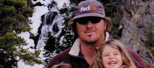 Brian 'Tigger' Stothart's wife, Valerie, describes him as a family man. Stothart holds his children, Samuel and Sophia, at Fish Creek Falls in May. This photo hangs on a tree along the Encampment River in Wyoming.