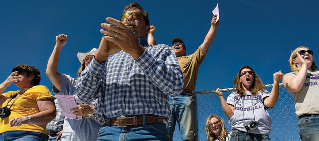 Little Snake River Valley School football fans cheer during one of the Rattlers' big plays Friday in Baggs, Wyo. Friday's junior varsity and varsity games were the first time that organized football had been played there since 1953.