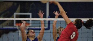 Steamboat Springs High School volleyball player Colleen King slams the ball past Moffat County High School defenders Thursday in Craig. Steamboat won, 3-1.