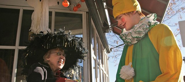 Barbara Stoddard, a local witch, hands out candy to Conner Jurgensen, 14, who is dressed as a clown for Halloween, during the downtown Trick-or-Treat Street on Saturday. Downtown businesses handed candy out during the event on Yampa Avenue.