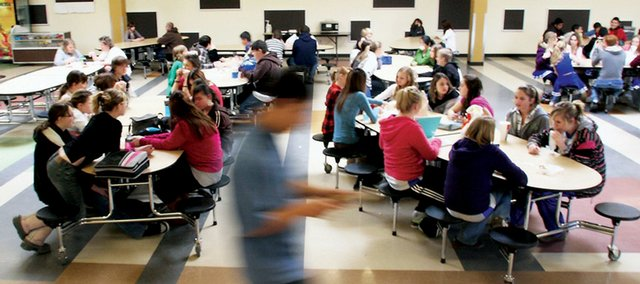 Eighth-grade students socialize in the cafeteria during lunch Thursday at Craig Middle School. Several students agreed that bullying happens almost every day within the school's walls, and that's a problem administrators said they are trying to address.