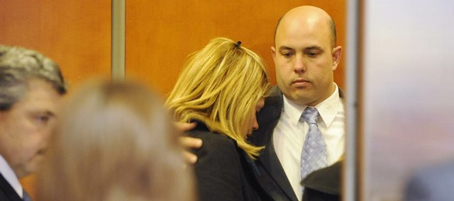 Eduardo Capote is comforted by his wife, Desiree, on the elevator this evening at the Routt County Justice Center in Steamboat Springs shortly after jurors found Eduardo and his brother David not guilty of third-degree assault charges. The jury was deadlocked on Eduardo's second-degree assault charge, and a new trial has been scheduled for May.