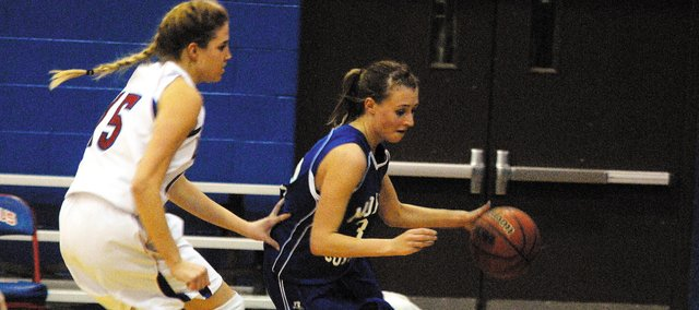 Moffat County High School junior Lauren Roberts, right, drives to the baseline in the third quarter of the Bulldogs' game versus Centaurus High School. MCHS wound up losing to the its division's No. 1 seed, 56-36, to knock the team out of the Class 4A state tournament.