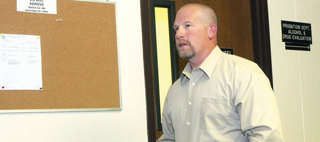 Ken Johnson, a former Craig Police Department detective, walks into Moffat County District Court this afternoon for his sentencing hearing. Johnson pled guilty in April to attempting to influence a public servant, a Class 4 felony. Check back with www.craigdailypress.com for updates on the hearing.