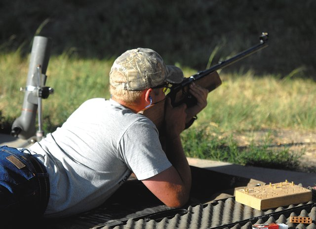 Mark Tuck, 17, shoots from the prone position Monday night at Bears Ears Sportsman Club. Tuck, who recently competed at the 2010 National 4-H Invitational in Texas, said he hopes to continue shooting after his time in 4-H concludes.