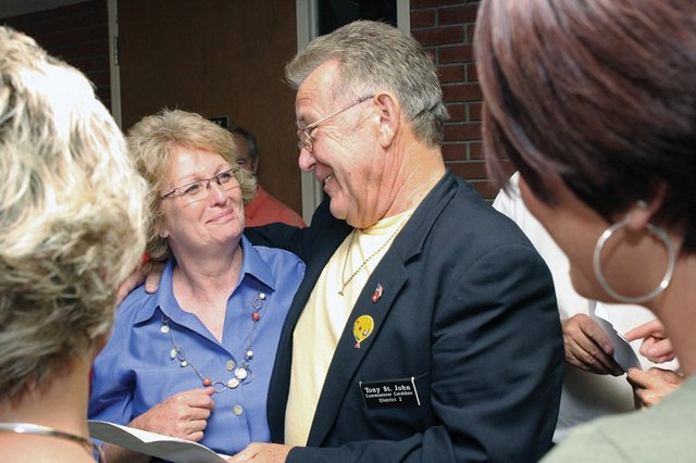Tony St. John, right, congratulates Audrey Danner, left, at the Moffat County Courthouse following Tuesday's Moffat County Republican primary election. Danner defeated St. John to win the Republican nomination for the District 2 county commission seat. She advances to November's general election.