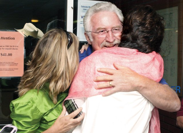 Tom Mathers, center, hugs his daughter Christina Oxley, left, and wife, Stacey Mathers, on Tuesday at the Moffat County Courthouse. Mathers, the incumbent, won the Republican nomination for the Moffat County Commission, District 3, seat over Frank Moe.