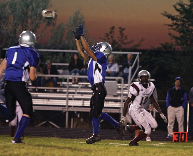Junior Miguel Molina jumps for an interception he caught in the first quarter of the Moffat County High School homecoming football game Friday at the Proving Grounds. Despite a close first half, MCHS lost to Palisade High School 36-6.