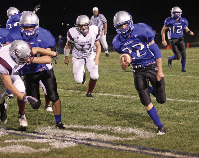 Junior Braeden Sullivan turns the corner for a 55-yard touchdown run last Friday against Palisade High School. The Bulldogs travel to Glenwood Springs High School to take on the top ranked team in the Western Slope League tonight.