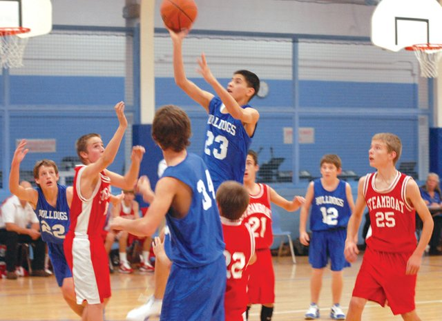 Eighth-grader Miguel Cruz goes up for a shot during Craig Middle School's basketball game against Steamboat Springs on Thursday at CMS. The eighth-grade A team won both the Steamboat game and the Saturday game in Rangely, adding to its 10-0 record.