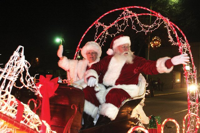 Mr. and Mrs. Claus wave to the crowd during last year's Parade of Lights. This year's parade is slated for 6 p.m. Saturday and will travel south on Yampa Avenue from Craig Middle School then west on Victory Way to Centennial Mall.