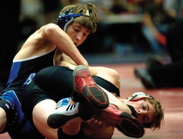 Moffat County High School's Cody Nelson looks to secure back points against second-round opponent Cody Clawson of Paonia. Nelson won the match and went on to finish sixth at the Warrior Classic in Grand Junction.