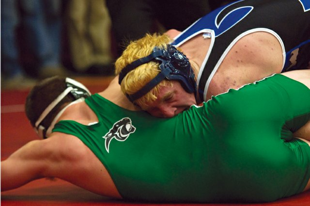 Moffat County High School wrestler Charlie Griffiths drives a Delta competitor to the mat during the Warrior Classic at Mesa State College. The MCHS wrestling team will compete Jan. 7 and 8 in the Las Vegas Tournament.