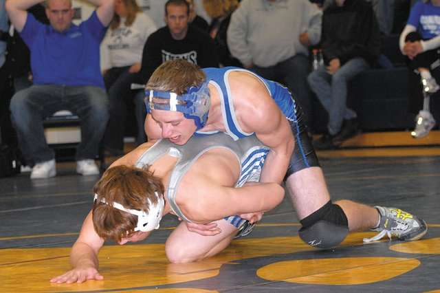 Garrett Stewart, top, a Moffat County High School sophomore, wrestles Coal Ridge High Schools Michael Shaw in round three of the Rumble in the Rockies Dual Team Tournament on Saturday at Rifle High School. The Bulldogs varsity wrestling team went 2-3 in the dual meet. 