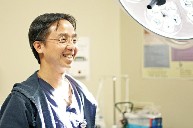 Dr. Tinh Huyn, a former U.S. Army major and current emergency room doctor at The Memorial Hospital in Craig, enjoys a light moment in the hospitals ER. Huyn served in Iraq, Kosovo, Macedonia and South Korea. He was recently hired full-time by the hospital.