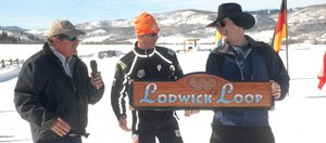 Lodwick Challenge organizers Johnny Fisher, left, and Erik Lunde present U.S. Nordic combined skier Todd Lodwick with a trail sign commemorating the Lodwick Loop at The Home Ranch in Clark on Sunday.