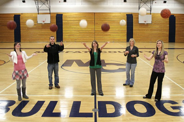 The Camilletti family, from left, Melissa, Dylon, Lisa, Sandy and Makayla, at their home away from home, the Moffat County High School gymnasium. Melissa, Lisa and Makayla, all members of the girls varsity basketball team, said they enjoy playing on the same team with family and also competing against each other for playing time.
