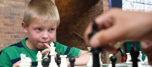 Second-grader Paxton Sollars ponders his next move while playing Coleman Bohmer during the Strawberry Park Elementary School Chess Club's tournament Thursday afternoon.