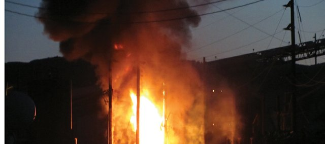 A transformer fire burns at the Twentymile Coal Mine electrical substation Tuesday night. West Routt Fire Protection District firefighters knocked down the blaze in about 20 minutes.          