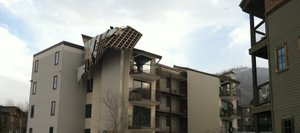 Residents of the Spring Meadows condo complex reported the roof blowing off at about 7 a.m. Thursday.