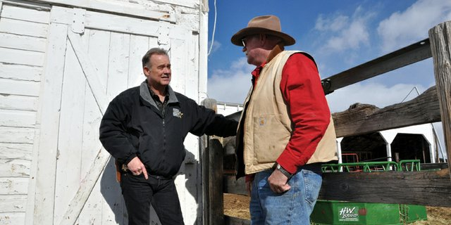 Gary Nichols, livestock investigator for the Moffat County Sheriffs Office, chats with local rancher and longtime friend Dave Seely on Friday. Nichols was recognized Jan. 12 as the 2011 Officer of the Year by the Colorado Cattlemens Association. 
