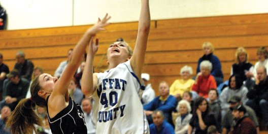 Makayla Camilletti, a Moffat County High School junior, puts up a lay-up against an Eagle Valley defender Jan. 13 at MCHS. The MCHS girls varsity basketball team won its first encounter with Eagle Valley, 57-27, and head coach Matt Ray said if his team plays fundamentally sound on both sides of the ball today, the Bulldogs should score another victory over the Devils.