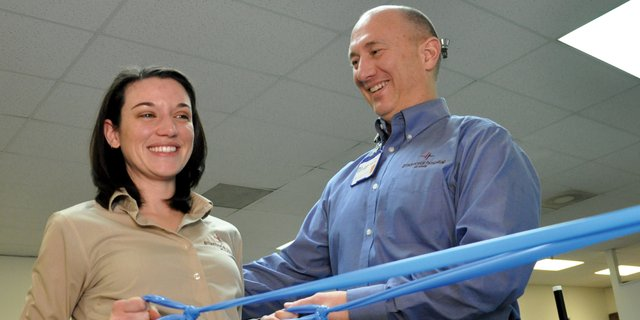Dale Little, right, physical therapy manager for The Memorial Hospital in Craig, and physical therapist Rachael Thomason demonstrate how to use a Thera-Band, a tool therapy patients can use at home, in the hospitals rehabilitation center inside Centennial Mall. George Rohrich, TMH chief executive officer, opened bids Friday for a renovation project that will enable the hospital to move its physical and occupational therapy services to TMH Medical Clinic.