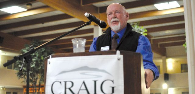 "Craig Mayor Terry Carwile addresses the audience Friday during his State of the City address, one of several speeches offered during the annual State of the County event at Holiday Inn. Sales tax revenues are up, but city officials are still approaching the 2012 budget with ""cautious optimism,"" he said."