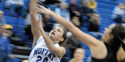 Melissa Camilletti, a Moffat County High School senior, throws up a shot Friday against Thompson Valley in the second round of the 4A state playoffs at Centaurus High School. Camilletti scored 17 points to lead the third-seeded Bulldogs to a 65-41 victory and a spot in the Sweet 16.