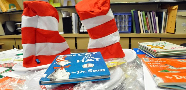 Dr. Seuss books and hats for Read Across America Day wait in Krista Schencks classroom Thursday afternoon at Moffat County High School. Schenck, Moffat County Education Association co-president, helped organize reading activities for the annual event, which took place Friday in Craig elementary schools.