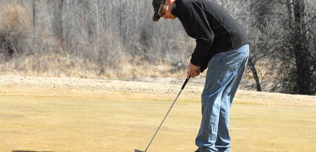 Daniel Brown, of Craig, putts on the eighth-hole green Friday at Yampa Valley Golf Course. Brown, the 2011 Men's Club champion, said with the course opening two weeks earlier than normal, he is able to keep his game in shape as he prepares to defend his club title.