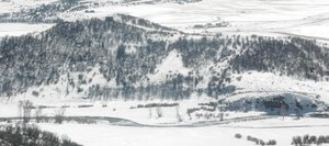 The Yampa River flows through a snow-covered hay field on Tailwaters Ranch, which sold in January for $17.65 million. The new owners plan to keep the ranch for their personal use as a trophy trout fishery.