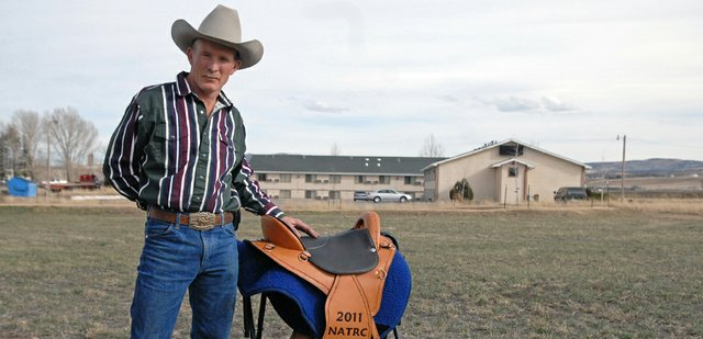 Craig resident Ken Wolgram poses with his brand new saddle, an award he received for winning the North American Trail Ride Conference Presidents Cup. Wolgram and his horse, Awesomes Fire N Ice, also took home the Jim Menefee, Bev Tibbetts and Polly Bridges awards completing the first ever grand slam in the NATRCs 51-year history.