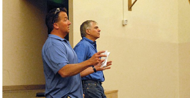 Mark Samuelson, left, and Tony Peroulis talk to Moffat County Booster Club members Wednesday in the Moffat County High School auditorium. Samuelson, the clubs vice president, and Peroulis, the clubs president, said the mission of the club is to help financially support extracurricular activities at MCHS and Craig Middle School.