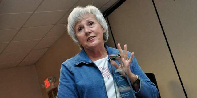 Bonnie Hampton, former Moffat County United Way board member and recently retired Twentymile Coal Mine employee, accepts an award on the companys behalf during an awards luncheon Wednesday at the Holiday Inn of Craig. Twentymile was the pacesetter for the 2012 United Way campaign and raised nearly $80,000 through employee contributions and matching company donations.