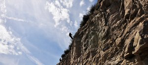 Carson Bartsch, top, rappels down a cliff with Matt Dossett on Tuesday in Mount Harris Canyon to start rock scaling operations above U.S. Highway 40. After loose rocks are removed, crews will install netting and fencing on the cliff for the first time to prevent rockfall.