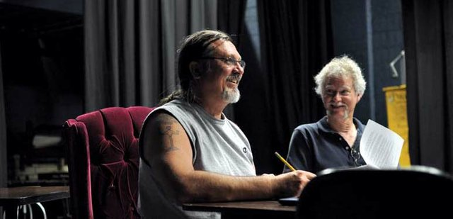 Bill Ronis pauses during a read-through of Taming the Wilderness, or the Founding of a Town on Monday night inside Craig Middle Schools auditorium. David Morris, a CMS English and theater teacher, took a tongue-in-cheek approach to the founding of Craig when he wrote the play, which Black Mountain Theatre is producing.