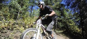 Greg Jansen rides down the Creekside Trail at Steamboat Ski Area during a 2010 downhill race. Not all of the planned bike trail construction at the ski area could be guaranteed to be completed in time for the Mountain States Cup events slated for July, which led to the cancellation of the race in Steamboat Springs.