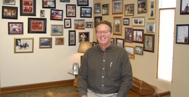 Kirk McKey displays his wall of fame at McKey Chiropractic Clinic, which includes clientele like entire families, area athletes and a former Colorado governor. McKey has lived in Moffat County since the 1970s, is an avid golfer and also serves as county coroner.