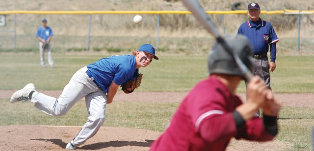 Moffat County High School junior Bubba Ivers unfurls a fastball during the second half of an MCHS varsity baseball game against Palisade. The Bulldogs went 0-2 on Saturday, losing 12-2 and 6-2.