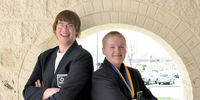 Moffat County High School seniors Adam Foster, left, Thomas McCoy, pictured here at the high school, depart Saturday for a national Distributive Education Clubs of America competition in Salt Lake City. They are the first students in MCHS history to qualify for national events in both DECA and Future Business Leaders of America.