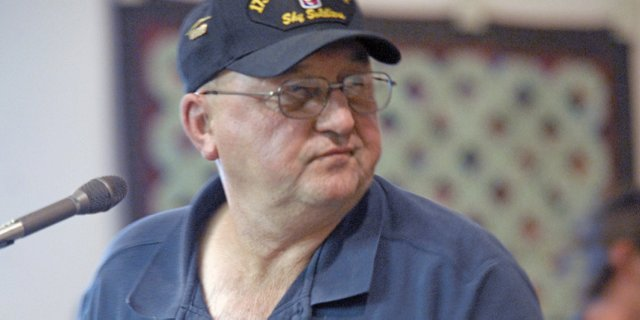 Larry Neu, quartermaster of Veterans of Foreign Wars Post 4265, turns in disgust Tuesday night during a discussion with Craig City Council members about reopening lease negotiations for Veterans Memorial Park.