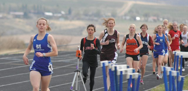 Moffat County High School junior Eryn Leonard leads the way in the girls 1600 meter run Friday at the Clint Wells Invitational. Leonard led the entire race, placing first with a time of 5:54.56