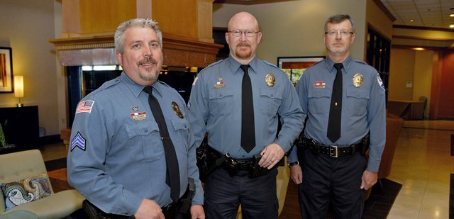 Craig Police Department members, from left, Sergeant Corey Wagner, Officer Mike Edwards and Officer Lance Eldridge were named Officers of the Year by the Colorado Law Enforcement Officers Association Friday for pulling a Craig resident from his burning house in February. The man, Patrick Hunter, later died from injuries sustained in the fire, but Hunters children both said the officers were deserving recipients. 